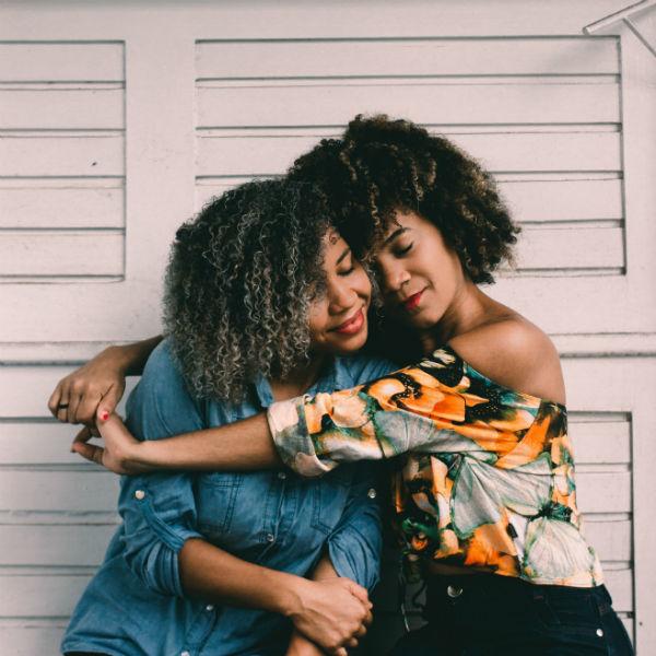 stress management tip two women hugging