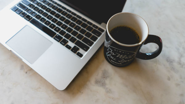 how to be more productive laptop and coffee