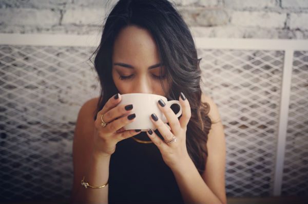 how to reduce anxiety woman drinking tea
