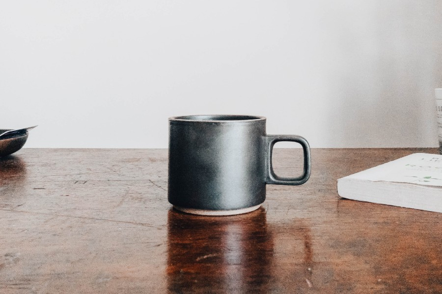 coffee cup sitting on hardwood table